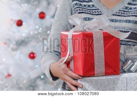 Cropped Shot Of Woman Holding Wrapped Christmas Gifts