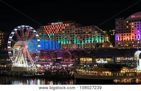 SYDNEY, AUSTRALIA - JUNE 7, 2015: Darling Harbour during Vivid Sydney festival. Vivid Sydney is an outdoor annual cultural event featuring immersive light installations and projections.