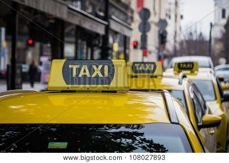 Yellow Taxi Signs In Budapest