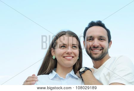 Happy Young Couple Outdoors In Summer Sunny Day