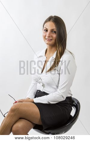 Beautiful Girl Sitting On Bar Chair