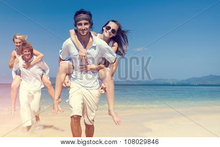 Two Couple Relaxing Beach Carrying Summer Leisure Concept