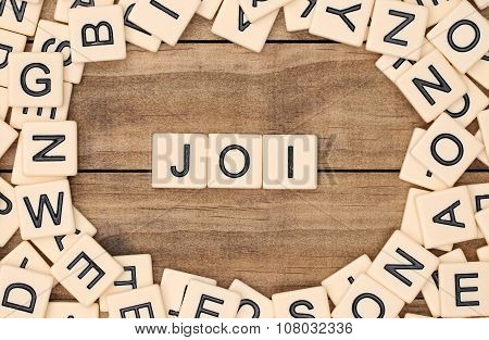 Joi - Joy In French Spelled Out In Tan Tile Letters