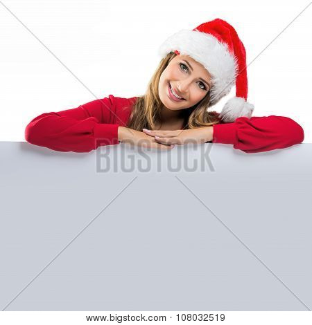 Christmas Women relies on the table behind