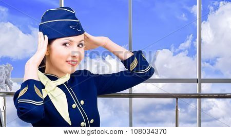 Smiling stewardess at the airport