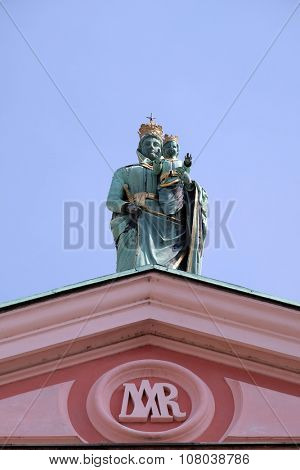 LJUBLJANA, SLOVENIA - JUNE 30: Madonna and Child at the top of the Franciscan Church of the Annunciation on Preseren Square in Ljubljana, Slovenia on June 30, 2015