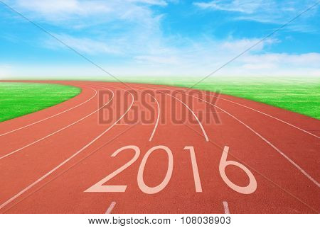 2016 On Red Racing Track With Green Grass And  Blue Sky