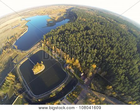 Photo of an autumn lake in forest with a bird's eye view