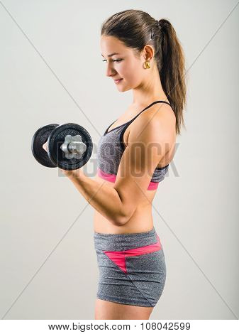 Young Woman Doing Single Dumbbell Curl
