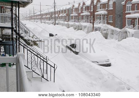 Snowfall in the city. Car and street under snow.