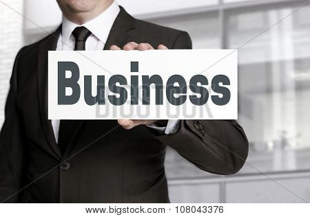 Business Sign Is Held By Businessman Concept