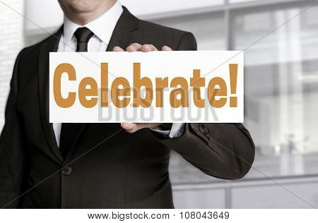 Celebrate Sign Is Held By Businessman Concept