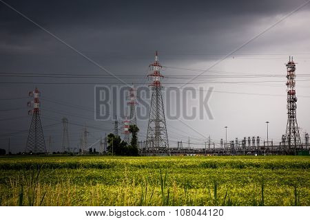 Voltage Pylons In A Field Of Wheat
