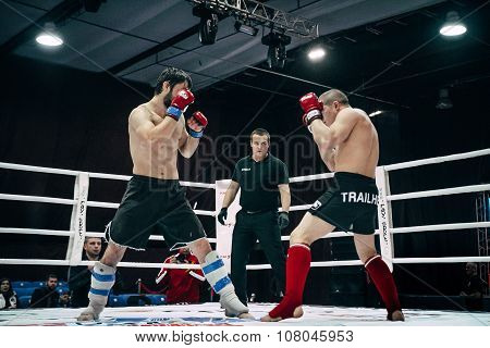 two athletes are in fighting poses on ring