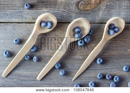 Blueberries On A Wooden Spoons
