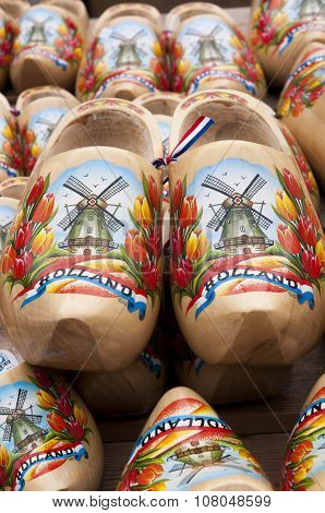 ALKMAAR - AUGUST 2015 : Typical dutch wooden clogs (klompen), painted with tulips and a windmill