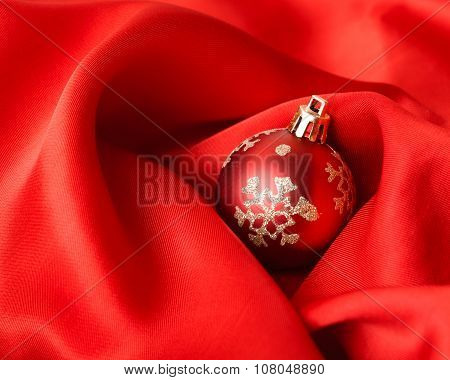 red Christmas balls, wrapped in cloth