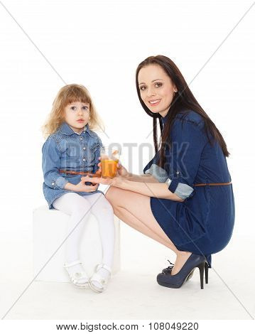 Young Mother Feeds  Her Child.
