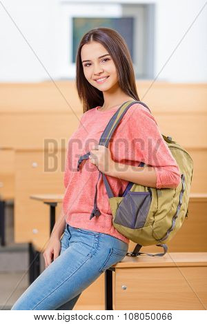 Young  student girl beside the desk