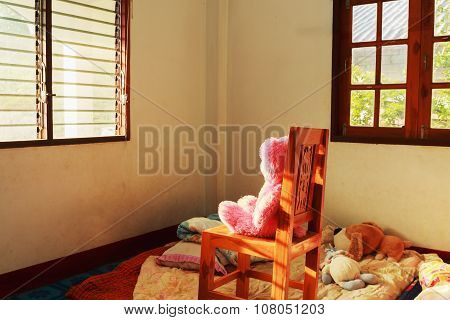 Doll Sitting On A Chair