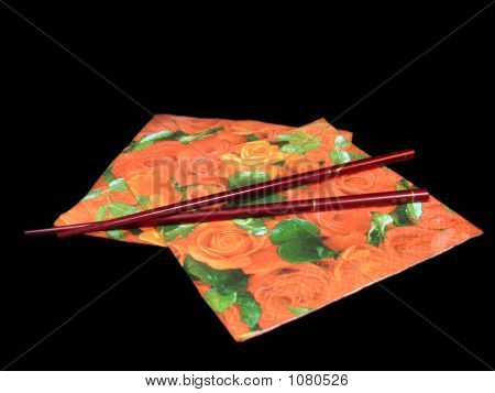 Red Napkins On Black Background With Chinese Sticks