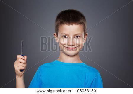 Little Boy Holding Screwdriver On Grey Background