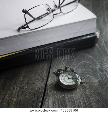 Pocket Watch Glasses And  Book  On Wooden Background