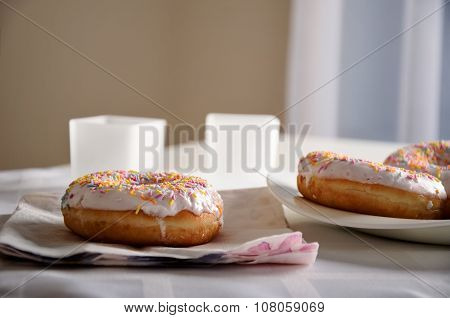 Donuts And Dishes On The Table. Horizontal