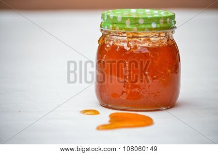 Exploded jar of marmalade