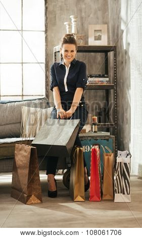 Beautiful Elegant Woman With Shopping Bags In Loft Appartment