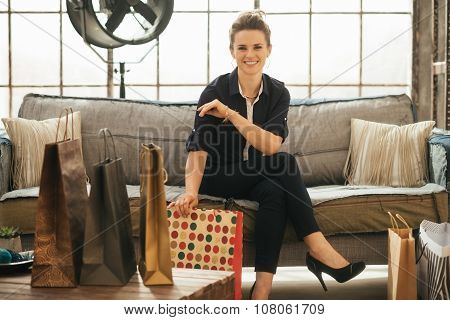 Stylish Brunette Woman With Shopping Bags In Loft Apartment