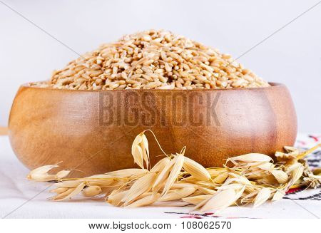 Oats In A Wooden Bowl And Ears Of Corn Oats