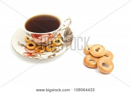 Different Bagels And Cup Of Tea On White