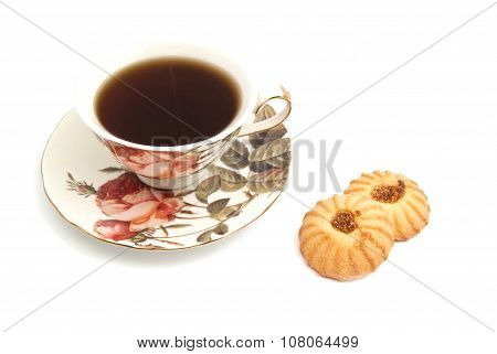 Cup Of Tea And Two Tasty Cookies