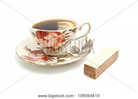 Wafer And Cup Of Tea With Lemon