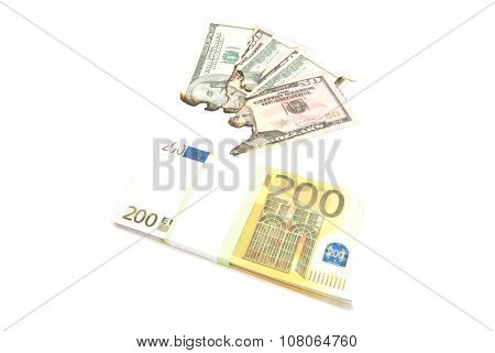 Pack Of Euros And Burned Dollars Banknotes