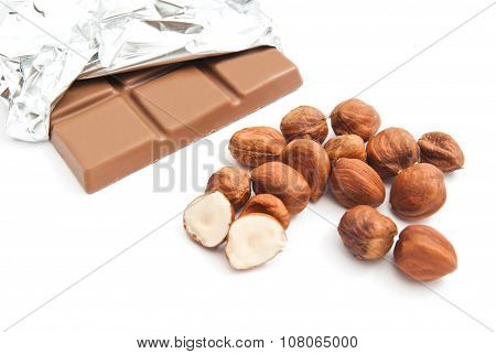 Chocolate Bar And Heap Of Hazelnuts