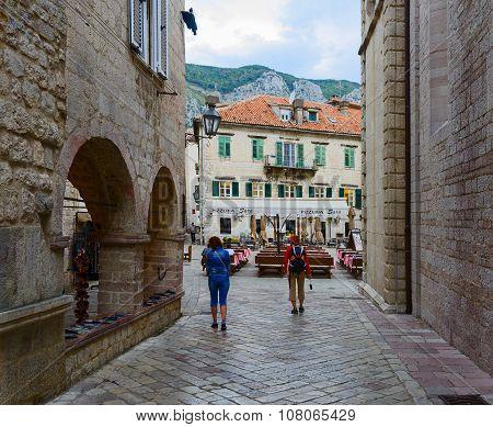 Tourists Walk Through Narrow Streets Of Old Town, Kotor, Montenegro