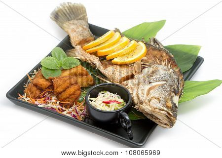 Fired Fish With Fishsauce And Mango Salad , Thai Food  Favorite