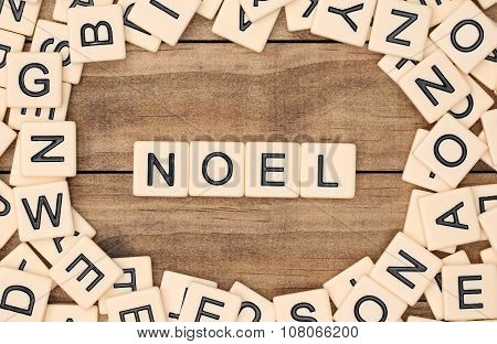 Noel - Christmas Spelled Out In Tan Tile Letters