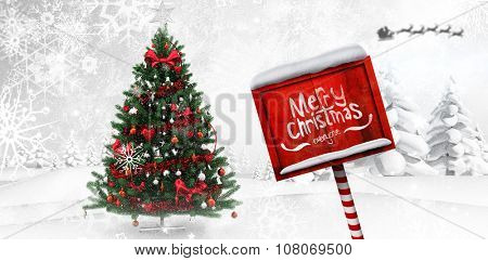 Merry Christmas message against christmas tree in snowy forest