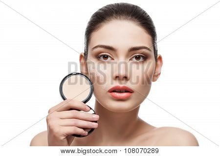 Girl with pressed powder in hand