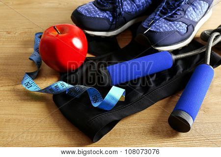 Sport shoes, clothes, equipment on light background