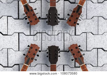 Guitars Top On Stone Pavement