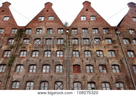 Facade of an old abandoned brick industrial building