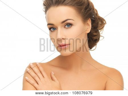 health and beauty concept - face and hands of beautiful woman with updo (can be used as a template for jewelry)