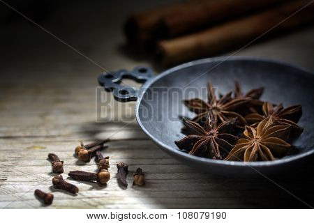 Baking Spices, Star Anise, Cinnamon And Cloves On A Rustic Wooden Table