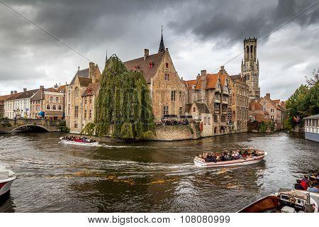 BRUGES, BELGIUM - OCTOBER 28, 2013: Tourists in boat, Bruges,Belgium