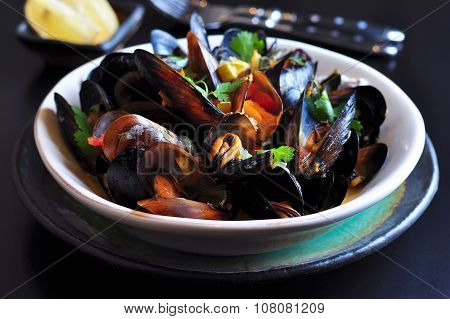 soup of wild mussels with white wine, vegetables, sage and coriander