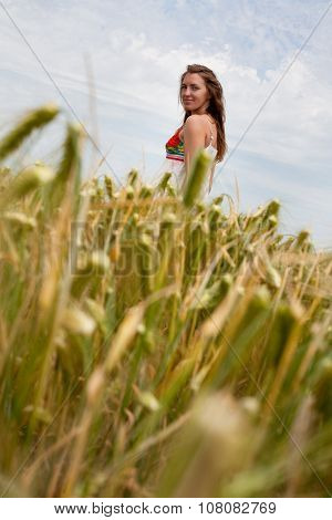 girl in a summer field of spikes